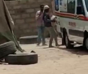 A photo of the ambulance being loaded with cement